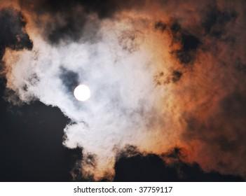 Sun high on black sky
