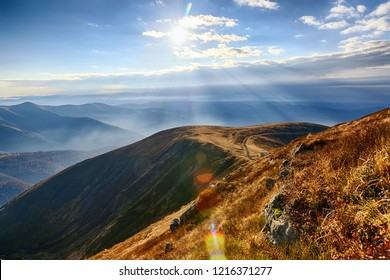 Sun at the highlands. Vibrant autumn alpine landscape