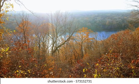 The sun is just starting to set along the Missouri River in autumn.  This breathtaking view was taken at Weston Bend State Park along the hiking trail.