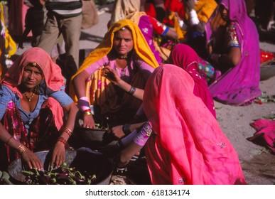 SUN KOSI, NEPAL - DEC 10, 1979 -Hindu women wait in the bazzaar at Sun Kosi, Nepal