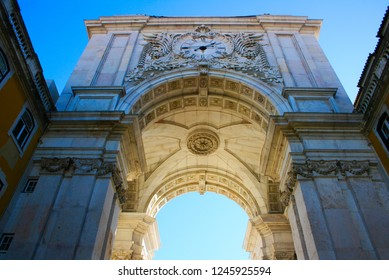 sun light passing through portuguese arquitecture arch, in Terreiro do Paço, in lisbon, Portugal.