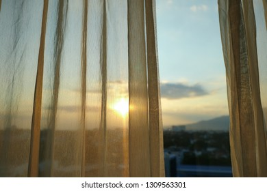sun light through white curtain interior of window in the morning