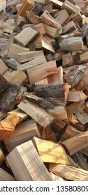 Sun lit pile of firewood fresh cut