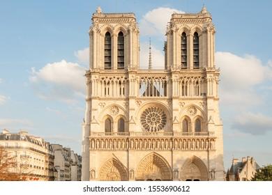 Sun lit undamaged facade of world famous Notre Dame de Paris on parvis Notre Dame (place Jean Paul II) square before the April 2019 fire, Paris, France
