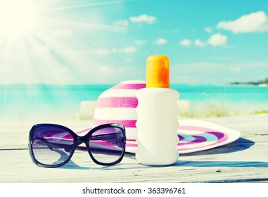 Sun lotion and sunglasses