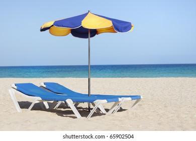 sun lounger chair on a beautiful beach