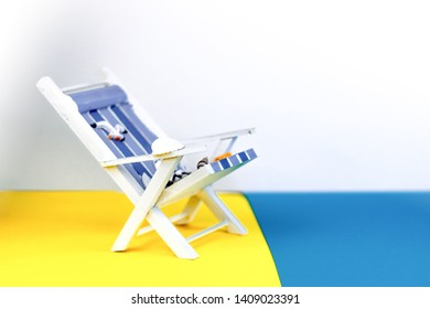 Sun lounger isolated on colourful background. Tropical vacation background. Sun lounger on the sandy island, copy space, front view