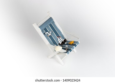 Sun lounger isolated on white background. Tropical vacation background. Sun lounger on the sandy island, copy space, front view