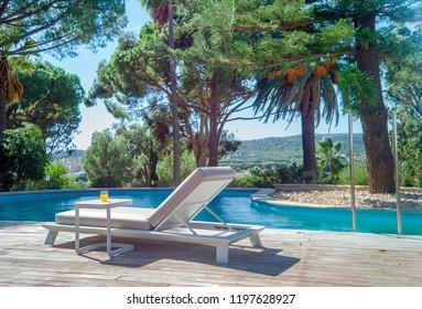 Sun lounger near pool.