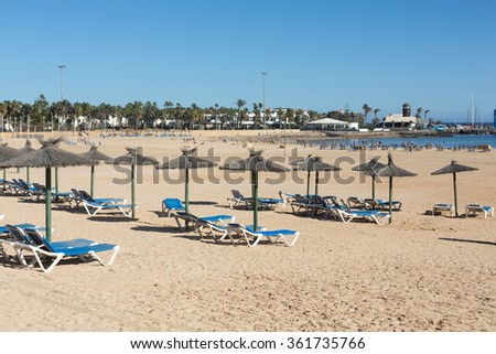 Sun lounger on the beach of Caleta de Fuste, Canary Island Fuerteventura, Spain
