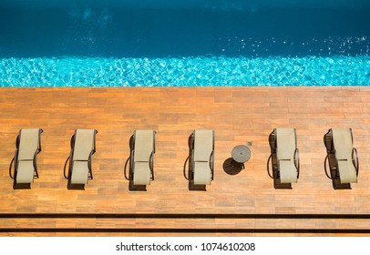 Sun loungers by the pool.