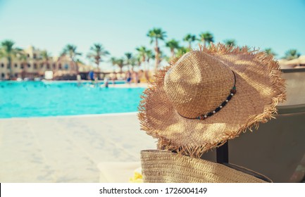 Sun loungers and a hat near the pool. Resort. Selective focus. nature.