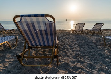 Sun loungers on the beach at the morning.