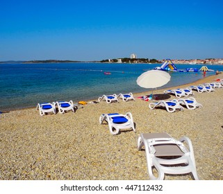 Sun loungers on the pebble beach in Vodice in Croatia.