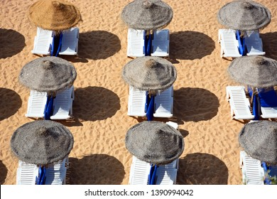 Sun loungers and parasols on the beach seen from above, Albufeira, Portugal, Europe.