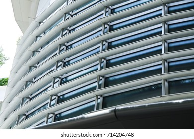 sun louver, modern office sun shade on facade lighting control. curve curtain wall adjustable light protection.