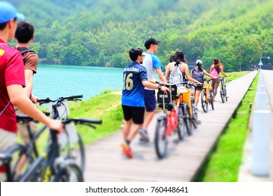 SUN MOON LAKE, Taiwan, about May,2017 : Group of bicyclists going around The Sun Moon Lake in Taiwan, blurred background