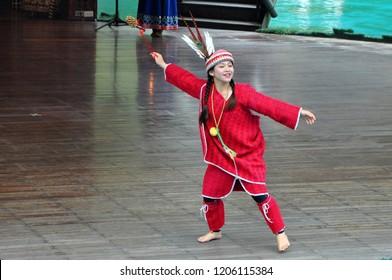 Sun Moon Lake, Yuchi, Taiwan, February 2015. Beautiful asian young girl in Atayal tribe costume dancing in Taiwanese Formosan Aboriginal Culture Village