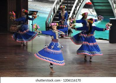 Sun Moon Lake, Yuchi, Taiwan, February 2015. Beautiful asian young girls in Bunun tribe costume dancing in Taiwanese Formosan Aboriginal Culture Village