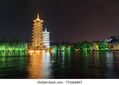 The Sun and Moon Pagoda at Night over the Lake Guilin China