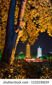 The Sun and Moon Pagodas illuminated at night, a tourist attraction in Guilin