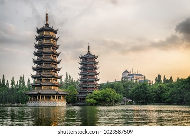 The Sun and Moon Twin Pagodas at sunset. Amazing evening view of Shanhu Lake (Fir Lake) in downtown of Guilin, China. Guilin is a popular tourist destination of Asia.
