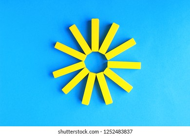 sun on a blue sky, summer background, motiv laid with yellow toy blocks