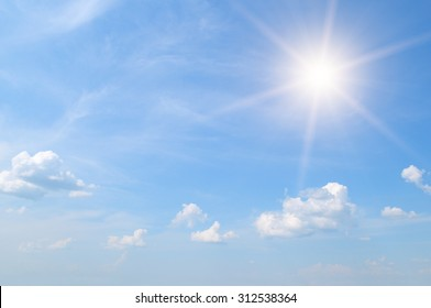 sun on blue sky with white clouds - Shutterstock ID 312538364