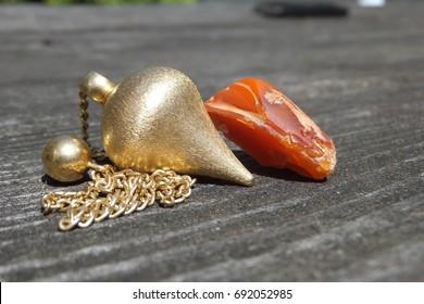 sun opal with pendulum