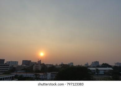 sun and orange sky when sunset in winter season at Bangkok