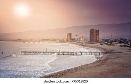 Sun over the beach in Arica in northern Chile, south America