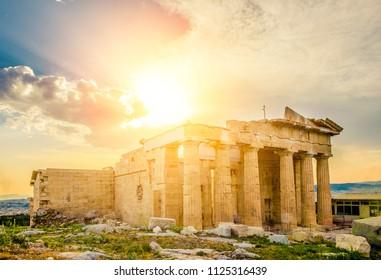 Sun over the Erechtheum temple ruins in Acropolis