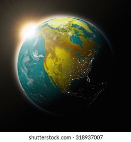 Sun over North America on blue planet Earth isolated on black background. Highly detailed planet surface. Elements of this image furnished by NASA.