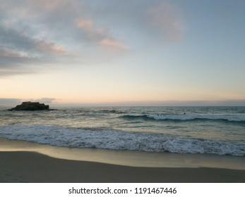 Sun over the sea horizon darkening