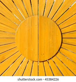 sun pattern on a wooden gate
