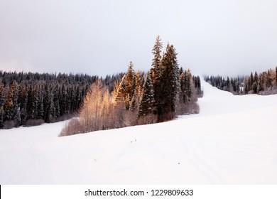 Sun Peaks empty ski slopes at sunset