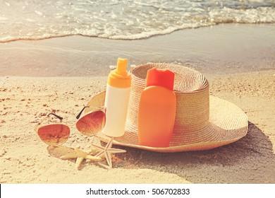 Sun protection set on beach. Skin care concept.