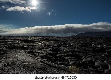 Sun and rain on lava plains at Kalapana, Volcanoes National Park, Big island, Hawaii