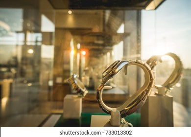 Sun ray on luxury watches displayed in shop exposition