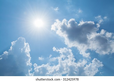 Sun rays against a blue sky in the clouds
