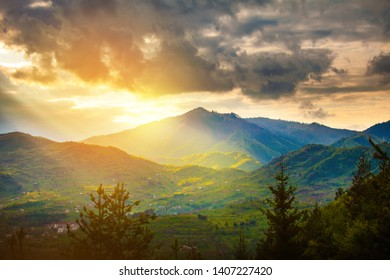 Sun rays beams over rural mountain resort epic landscape