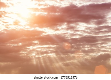 Sun rays breaking through cumulus clouds. The concept of divine light, a glimmer of hope or overcoming difficulties. Spiritual religious abstract background.