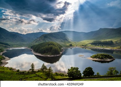 Sun rays bursting through storm clouds, The Lake District, Cumbria, England