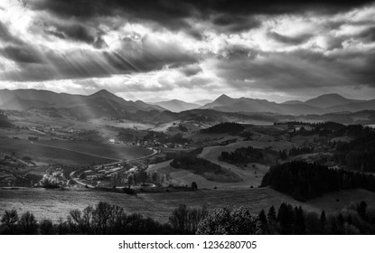 Sun rays and cloudscape over rural country. Cloudscape at sky. Black and white photo