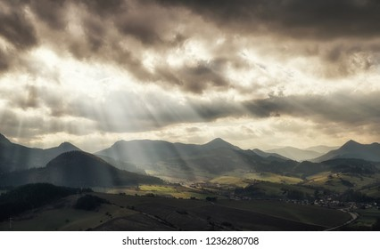 Sun rays and cloudscape over rural country. Cloudscape at sky. Region Orava, Slovakia