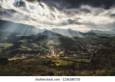 Sun rays and cloudscape over rural country. Cloudscape at sky.Village Vysny Kubin, Slovakia