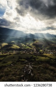 Sun rays and cloudscape over rural country. Cloudscape at sky. Village Vysny Kubin, Slovakia