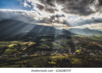 Sun rays and cloudscape over rural country. Cloudscape at sky. Region Orava, Slovakia. Hill Choc in clouds