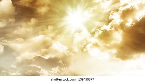 Sun rays in cloudy sky