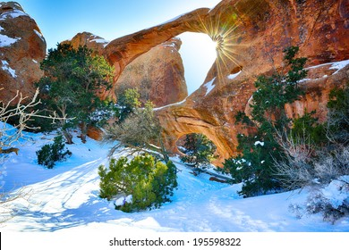 Sun rays coming through the Double-O-Arch in Devil's Garden in Arches National Park, Utah in winter, HDR